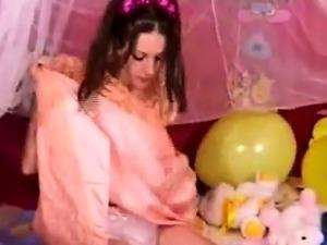 2 Beautiful teens play wearing diapers in their bedroom