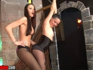 You are in Alexis Grace's dungeon.  She has Michelle Peters tied to the...