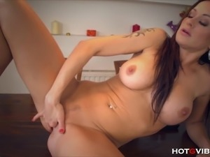 The amazing seductive euro MILF, Stacy Silver, arouses herself by using the...