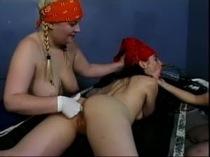 Two girls wearing a bandana having sex in jail