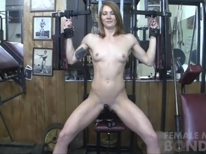 Redhead Charlotte Rides Fuck Toy in the Gym