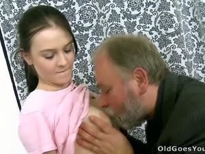 Slim brunette chick lets an old man lick her boobs