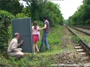 A guy jerks off while watching a couple fucking outdoors