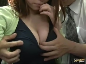Slutty Japanese girl gives a blowjob to a guy in a crowded bus