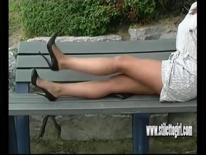 Sexy blonde with shapely legs teases in tall black stilettos