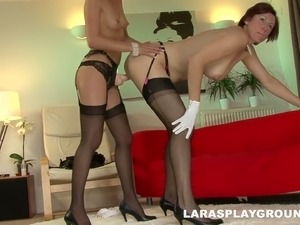 Seductive curvy mommy Cyprus gets fucked with strapon by her girl