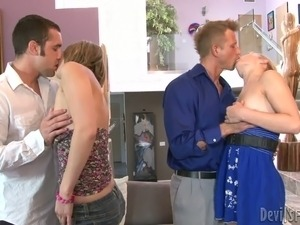 Two swinger couples go wild on the couch