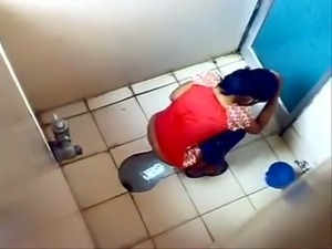 Some amateur Indian brunette gals peeing in the toilet on voyeur cam