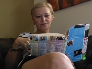 Old babe puts aside her magazine and masturbates tenderly