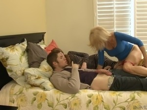 Blond haired old slut Erica Lauren pleasures young stud with stout DT while...