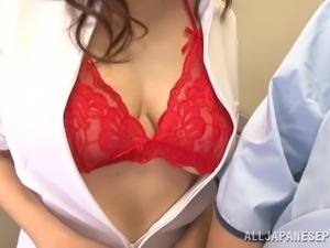 Beautiful Japanese nurse in glittering red bra having her big tits caressed...