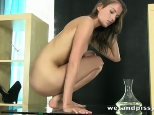 Skinny brunette filth Silvia Luca fingerfucks and drinks piss at the same time