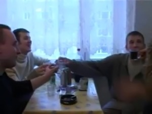 MILF fucked by three young guys in the kitchen