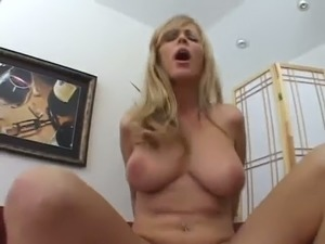 Big boobed blonde Nicole Moore is just a regular woman who loves sex