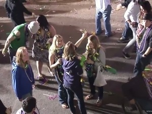 Party girls flashing their tits on the street for beads