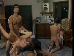Salacious Ginger Lynn having fun with her two lusty fuckers