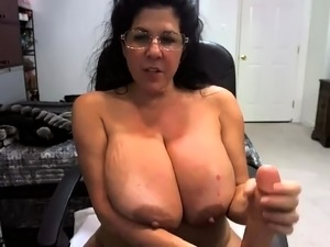 Voluptuous mature wife fucks herself with a dildo on webcam