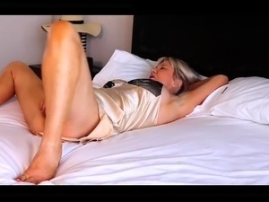 Stacked mature blonde gets fucked by a masked guy on the bed